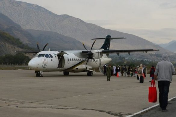 Passengers for a Pakistan International Airlines (PIA) flight line up to board a plane for Islamabad in Chitral on November 1, 2015. Image: FAROOQ NAEEM/AFP/Getty Images