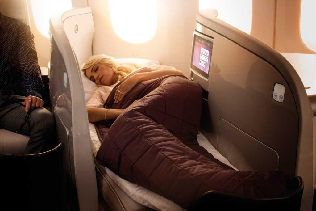 Boeing_787-9_BusinessPremier_Lie_Flat_Bed_Lady_Sleeping